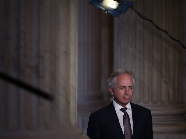 Sen. Bob Corker (R-TN) does a television interview at the U.S. Capitol on Oct. 9, 2013 in Washington, DC.
