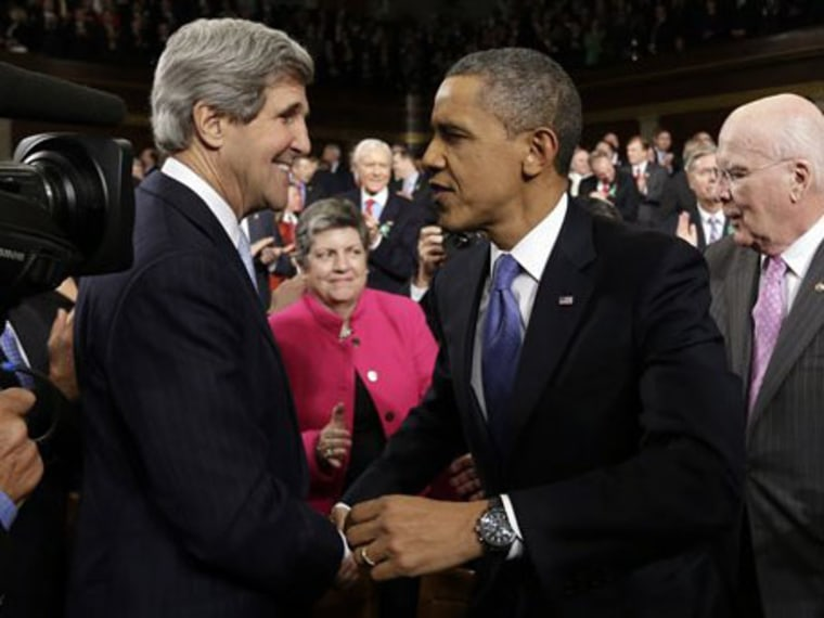 Secretary of State John Kerry greets President Barack Obama before the president's State of the Union address during a joint session of Congress on Capitol...