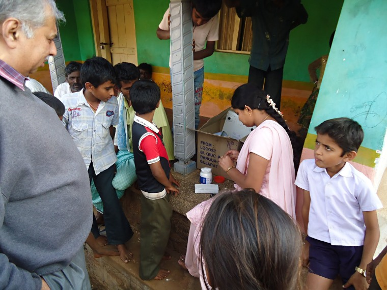 In a village in India, about 35 kilometers away from the closest government hospital, a Sucre Blue community worker provides health education to kids by explaining some of the risk factors associated with non communicable diseases.