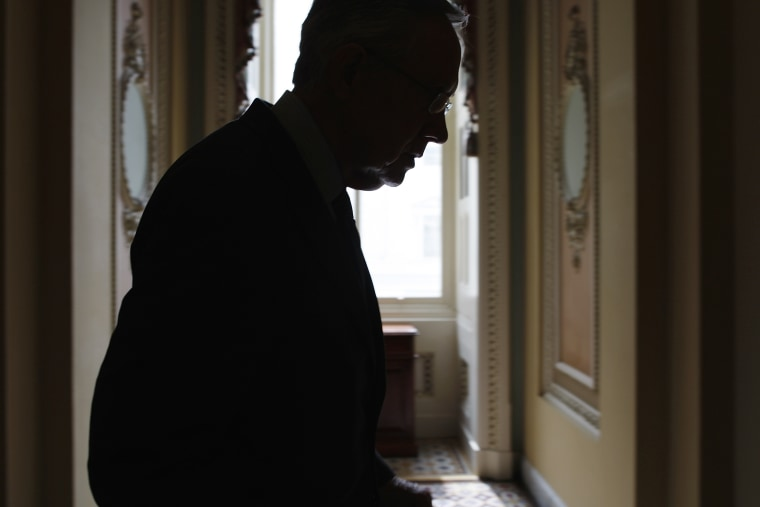 U.S. Senate Majority Leader Harry Reid returns to his office after a news conference at the U.S. Capitol in Washington on Oct. 3, 2013.