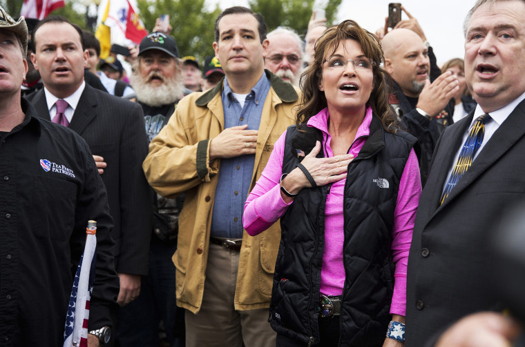 """Former Alaska Governor Sarah Palin and Senator Ted Cruz (C) (R-TX) recite the Pledge of Allegiance during the """"Million Vet March on the Memorials"""" at the U.S. National World War II Memorial in Washington on Oct. 13, 2013."""
