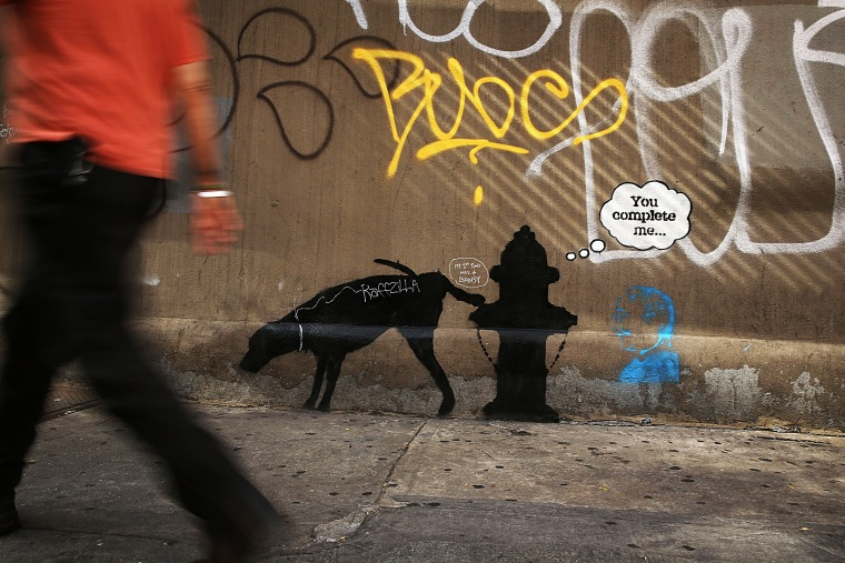 A new Bansky work on a side of a wall is viewed on Oct. 3, 2013 in New York City.