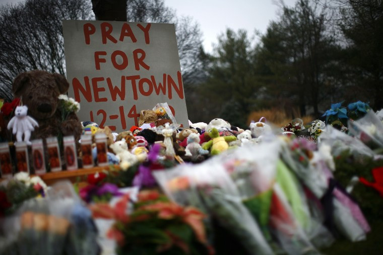 Flowers, candles and stuffed animals are seen at a makeshift memorial in Newtown, Connecticut on Dec. 17, 2012.