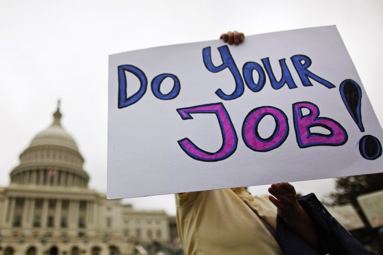 Federal workers demonstrate for an end to the U.S. government shutdown on the west front of the U.S. Capitol in Washington on October 13, 2013.