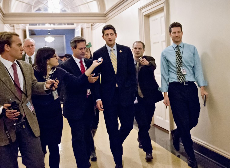 House Budget Committee Chairman Rep. Paul Ryan, R-Wis., center, is pursued by reporters on Capitol Hill in Washington on Thursday, Oct. 10, 2013