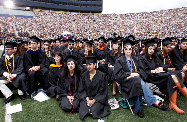 Graduating students listen to U.S. President Obama speak during commencement at the University of Michigan