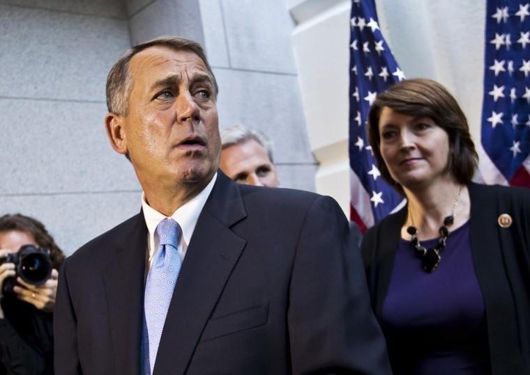 Speaker of the House John Boehner with House House GOP leaders, speaks with reporters following a Republican strategy session, at the Capitol on Oct. 15, 2013.