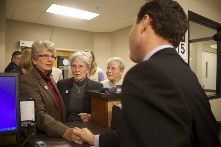 Brenda Clark (left) and Carol McCrory making their fifth request for a marriage license