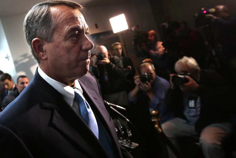 Speaker of the House Rep. John Boehner (R-OH) answers questions from the press followiong a meeting of House Republicans at the U.S. Capitol on Oct. 15, 2013 in Washington, DC.