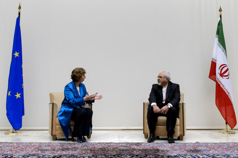 EU High Representative for Foreign Affairs Catherine Ashton (L) speaks with Iranian Foreign Minister Mohammad Javad Zarif during a photo-op prior the start of two days of closed-door nuclear talks