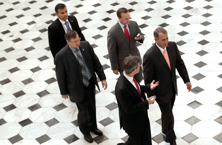 Speaker of the House John Boehner (R-OH) (R) walks from the House floor following a vote on Oct. 10, 2013 in Washington, DC.