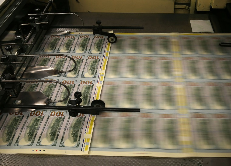 Newly redesigned $100 notes are printed at the Bureau of Engraving and Printing on May 20, 2013 in Washington, DC.
