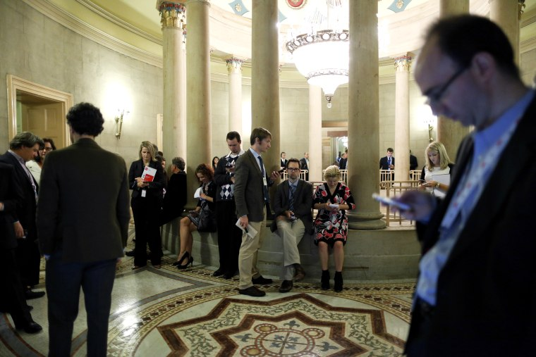 Reporters gather outside of a Republican Senate caucus meeting and wait for senators' remarks at the U.S. Capitol in Washington October 16, 2013.