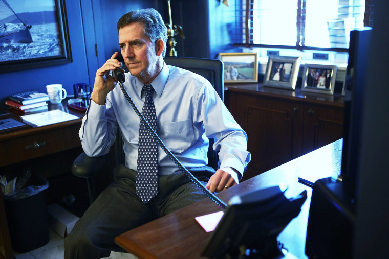 U.S. Senator Jim DeMint talks on the phone in his office December 6, 2012 on Capitol Hill in Washington, DC.
