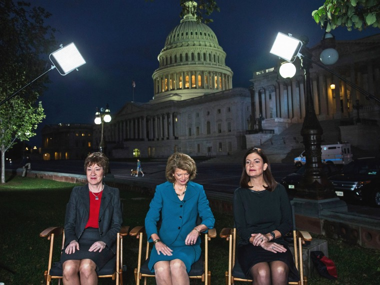 Sen. Susan Collins, Sen. Lisa Murkowski, and Sen. Kelly Ayotte prepare to appear on national television on the morning of October 16, 2013 in Washington, DC.
