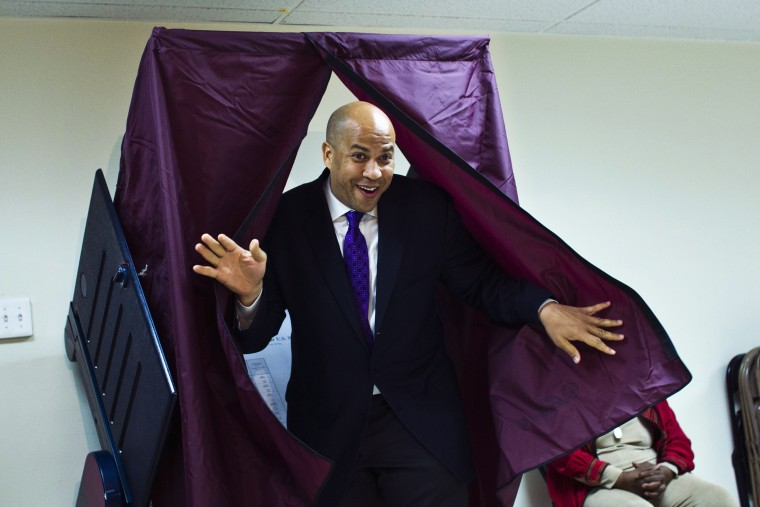 Newark Mayor and U.S. Senate candidate Cory Booker leaves a polling station after casting his ballot during the Senate primary election in Newark, New Jersey, October 16, 2013.