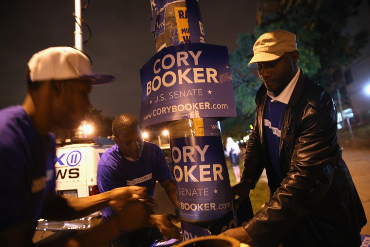 Campaign workers for Newark Mayor Cory Booker put up signs outside a polling station  for a special U.S. Senate election on October 16, 2013 in Newark, New Jersey.