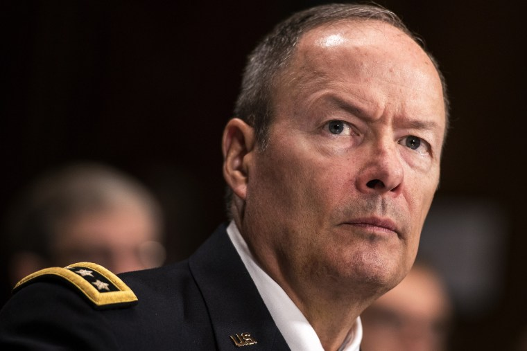 General Keith Alexander, Director of the National Security Agency, listens during a hearing of the Senate Judiciary on Capitol Hill October 2, 2013 in Washington, DC.