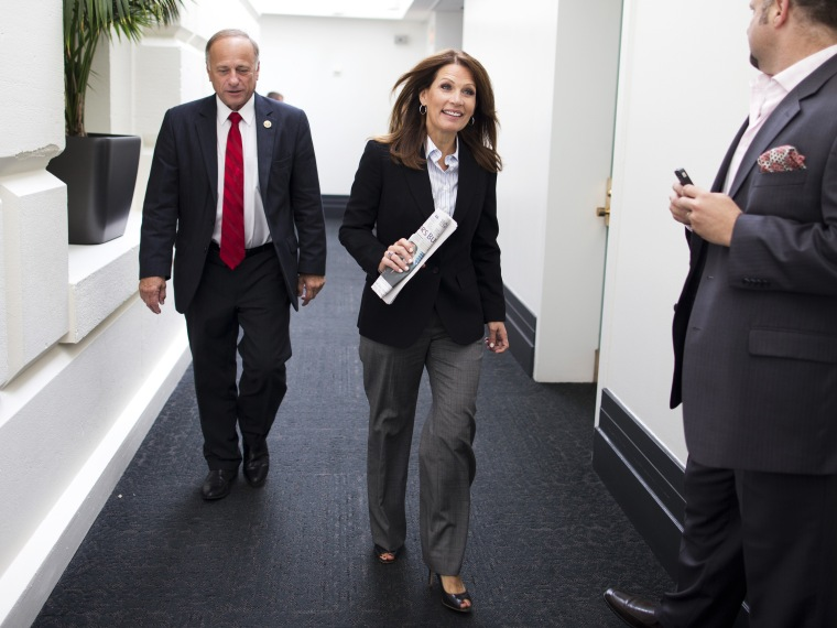 Rep. Steve King and Rep. Michele Bachmann leave a House Republican conference meeting on Capitol Hill on Saturday, Oct. 12, 2013 in Washington.