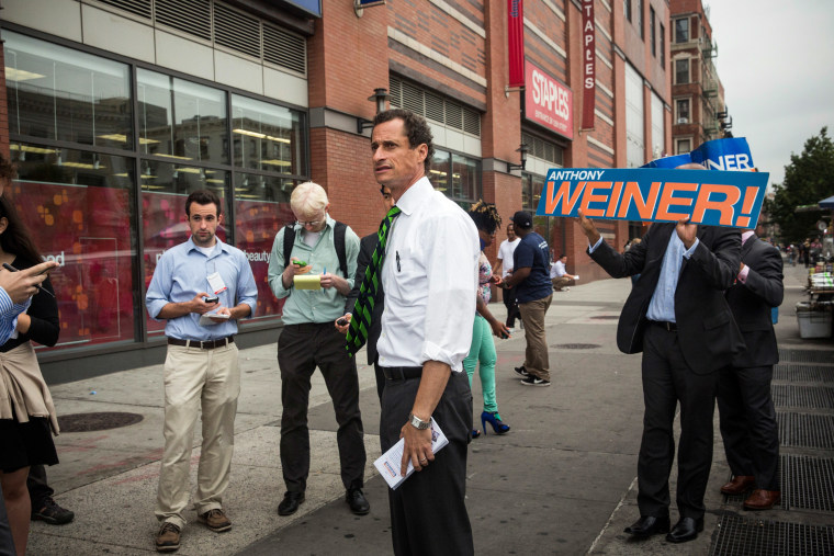 New York City mayoral hopeful Anthony Weiner meets with people on a street corner In Harlem on September 10, 2013 in New York City.