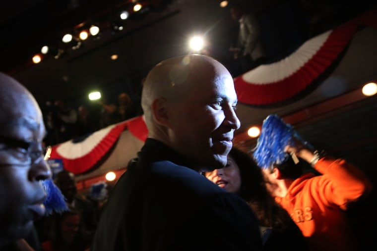 Newly elected U.S. Senator Cory Booker walks on stage to speak after winning a special election on October 16, 2013 in Newark, New Jersey.
