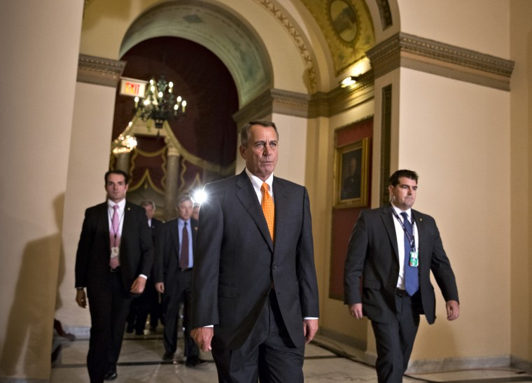 Speaker of the House John Boehner walks to the chamber for the vote on a Senate-passed bill that would avert a threatened Treasury default and reopen the government in Washington, Wednesday, Oct. 16, 2013.