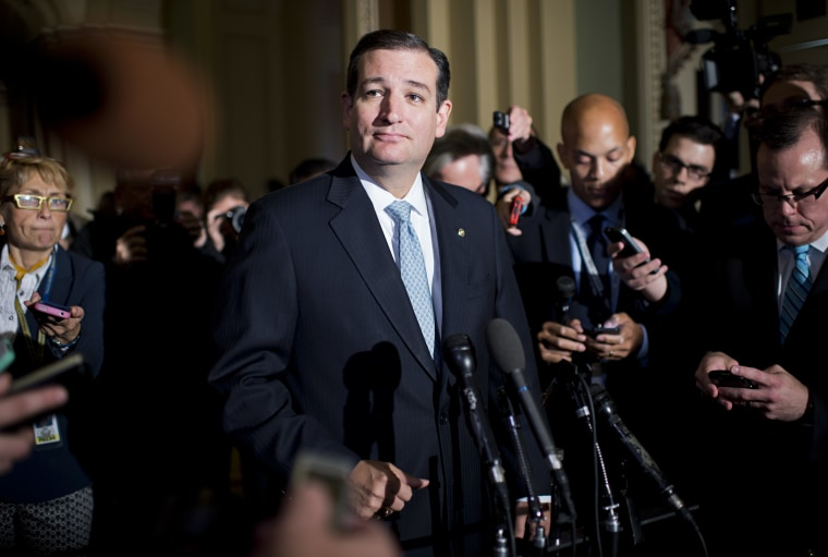 Sen. Ted Cruz, R-Texas, talks with reporters after a meeting of Senate republicans in the Capitol.