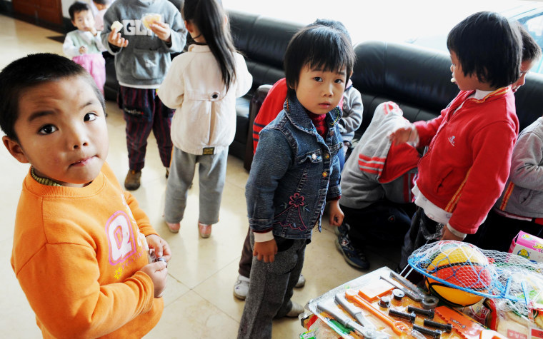 A group of 60 children are waiting to reunite with their parents after police rescued them from human traffickers at Guiyang Welfare Center for Children in Guiyang, southwest China's Guizhou province on October 29, 2009.