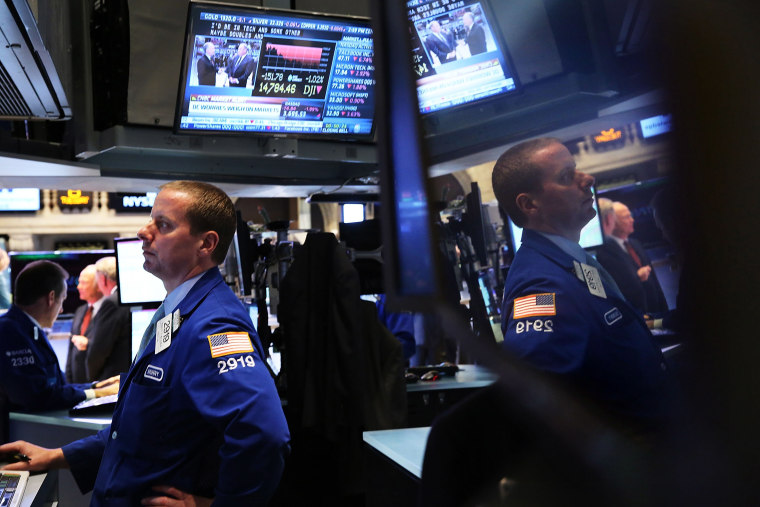 Traders work on the floor of the New York Stock Exchange minutes before the closing bell on October 8, 2013 in New York City.