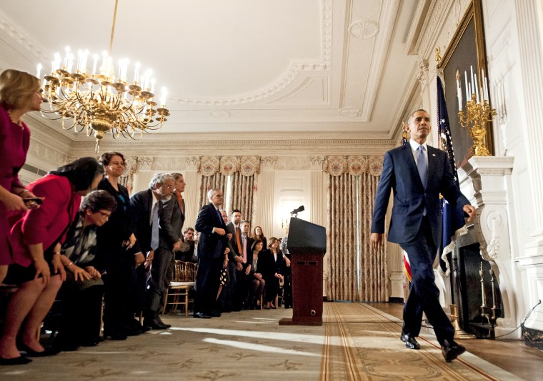 US President Barack Obama leaves after speaking about the reopening of government following a shutdown in the State Dining Room of the White House in Washington, DC, October 17, 2013.