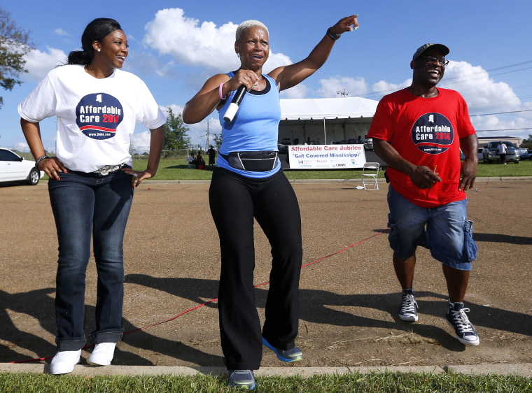 Deborah Jones leads local residents in an exercise at a rally held by supporters of the Affordable Care Act outside the Jackson-Hinds Comprehensive Health Center in Jackson, Mississippi October 4, 2013.