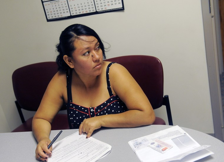 Rosa Ayala Cruz applies for health benefits at the Denver Health Westside Family Health Center on October 01, 2013 in Denver, Colorado.