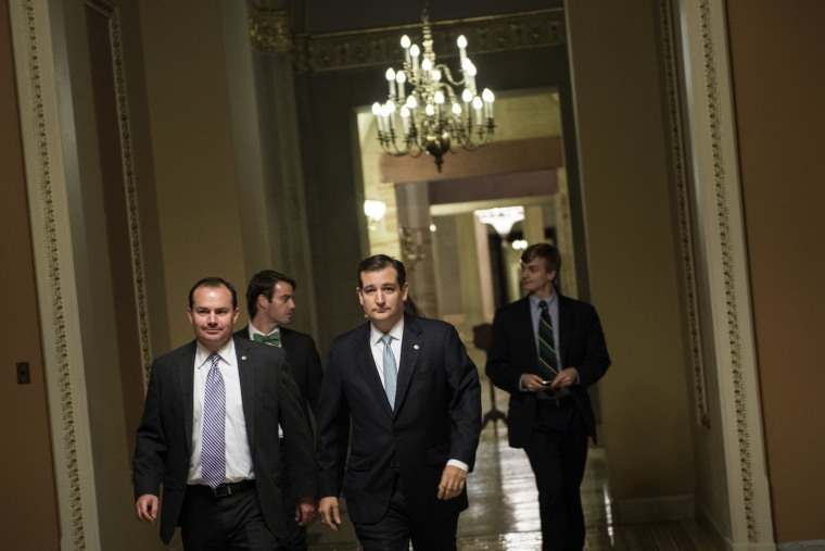 Senator Ted Cruz walks to a vote on Capitol Hill October 16, 2013 in Washington, DC.