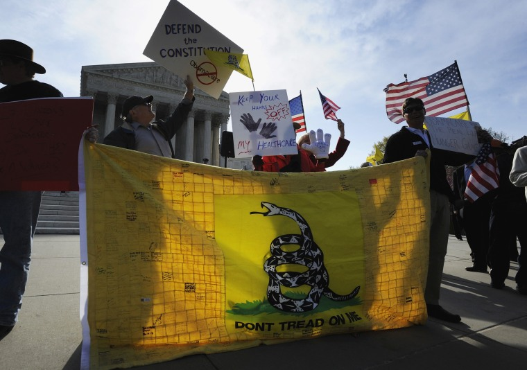 Tea Party supporters rally against Obama healthcare legislation during the third and final day of legal arguments over the Patient Protection and Affordable Care Act in Washington