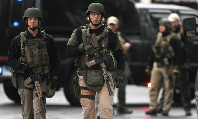 A Connecticut State Police tactical team searches a train station near an elementary school, which was in a lockdown, in Ridgefield, Conn. on Dec. 17, 2012 following the shooting at Sandy Hook Elementary School in Newtown.