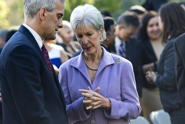 US Secretary of Health and Human Services Kathleen Sebelius speaks with White House Chief of Staff Denis McDonough following an event with President Barack Obama to speak about the Affordable Care Act, the new healthcare laws, in the Rose Garden of the Wh