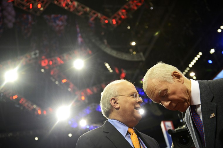 American political consultant Karl Rove and Senator Orrin Hatch from Utah share a word at the Republican National Convention on August 27, 2012.