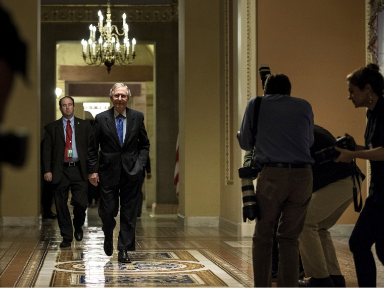 Senate Minority Leader Senator Mitch McConnell walks to a vote on Capitol Hill October 16, 2013 in Washington, DC.