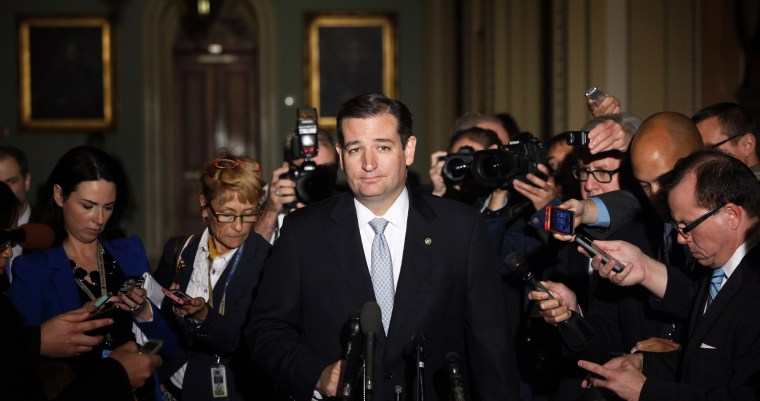 Reporters gather around U.S. Senator Ted Cruz as he talks to reporters after a Republican Senate caucus meeting at the U.S. Capitol in Washington October 16, 2013.