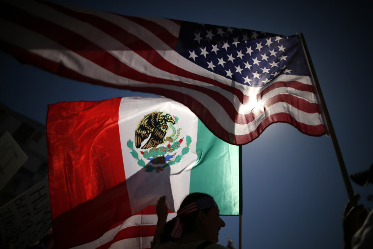 Protesters carry American and Mexican flags on their march to demand immigration reform in Hollywood