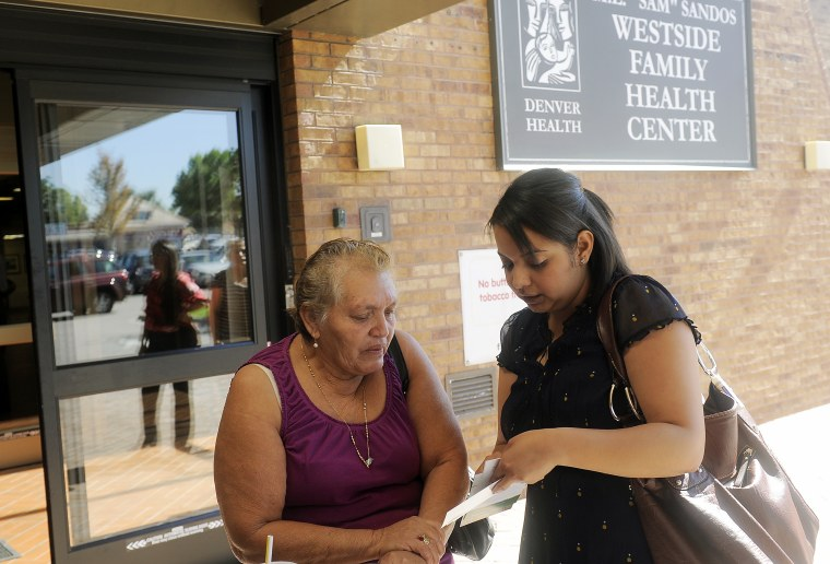 Lida Galindo talks with Mirian Morales,about the Affordable Care Act outside of the Denver Health Westside Family Health Center on October 01, 2013 in Colorado.