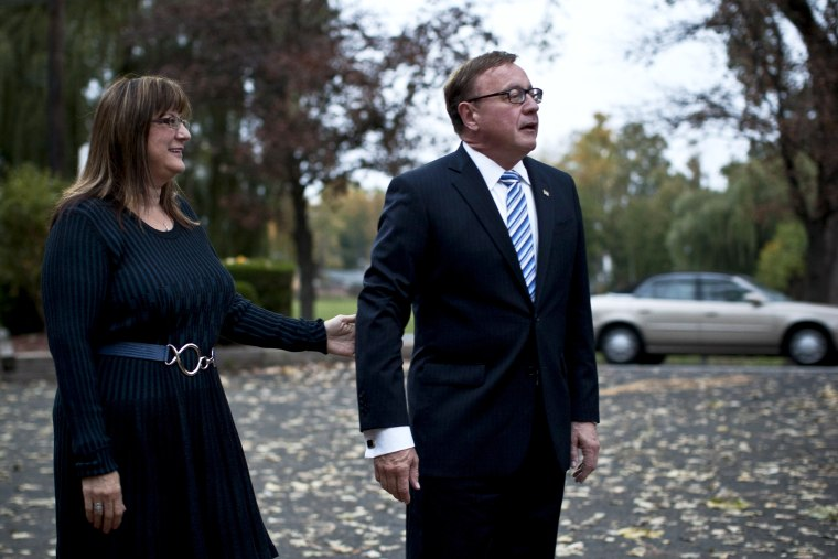 New Jersey U.S. Senate candidate Steve Lonegan and his wife Lorraine Rossi Lonegan arrives at a polling center on October 16, 2013 in Bogota, New Jersey.