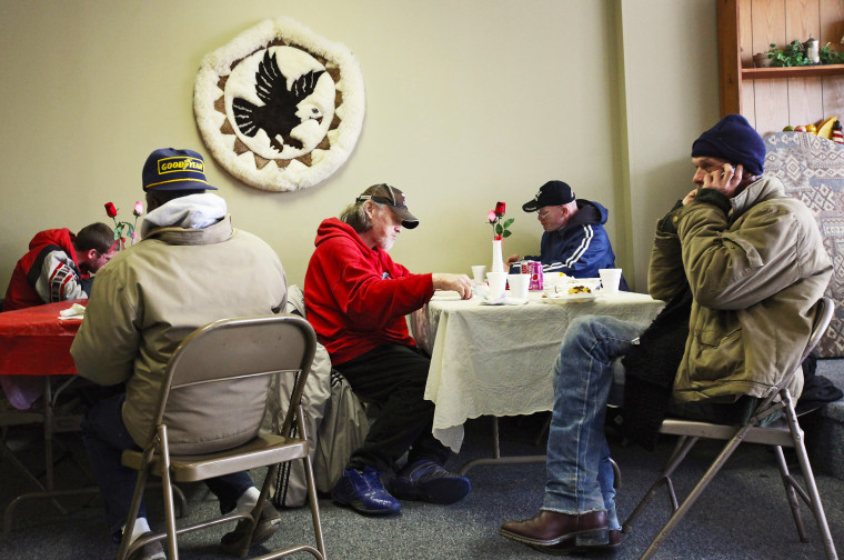People eat a free community meal at The Center on March 4, 2012 in Lima, Ohio. A census report released in 2011 showed that 15.3 percent of Ohioans live in poverty, the highest rate in the state in more than 30 years.