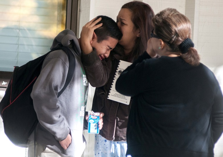 Sparks Middle School student cries after being released from Agnes Risley Elementary School, where some students were evacuated to after a shooting at SMS in Sparks, Nev. on Monday, October 21, 2013 in Sparks, Nev.