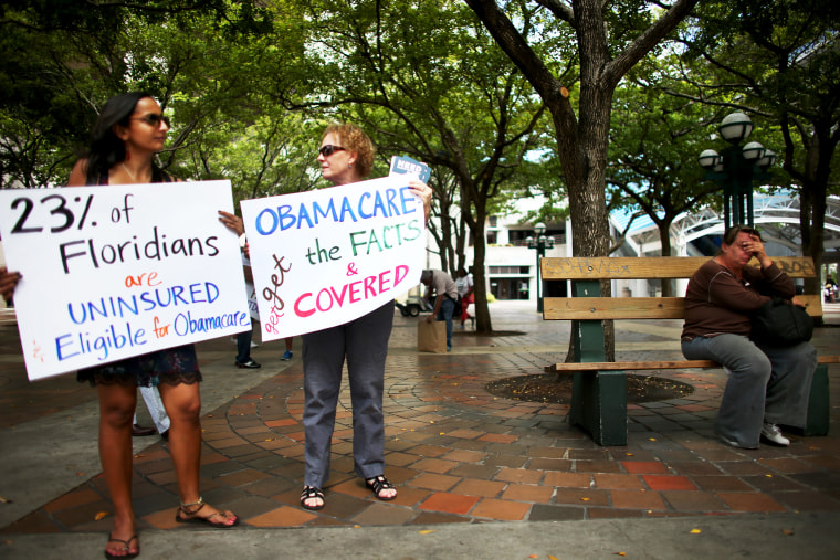 Supporters of the Affordable Care Act rally in Miami on October 10, 2013.