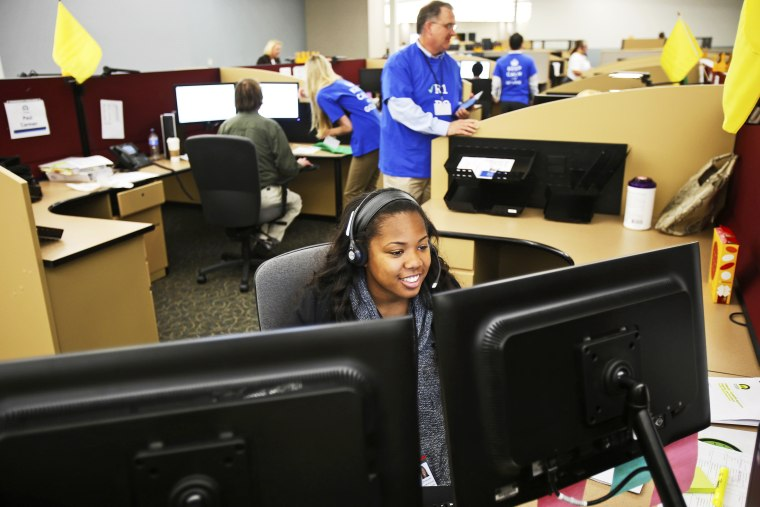 Shaldonia Barney, a service agent at Covered California's Concord call center, takes a call during the opening day of enrollment of the Patient Protection and Affordable Care Act in Concord, California October 1, 2013.