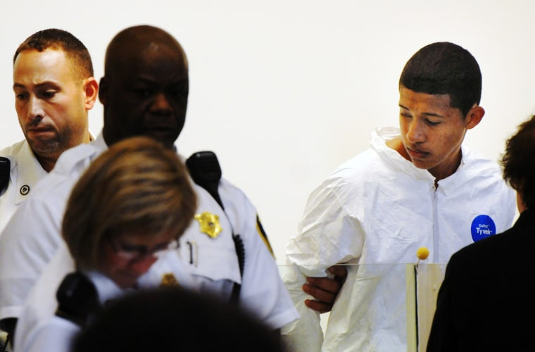 Philip Chism, 14, stands during his arraignment for the death of Danvers High School teacher Colleen Ritzer in Salem District Court in Salem, Mass., Wednesday, Oct. 23, 2013.