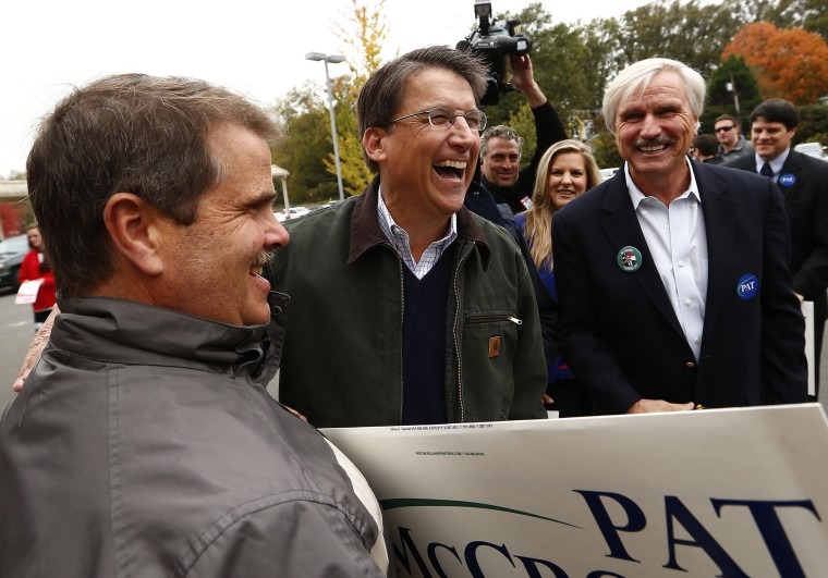 North Carolina Governor Pat McCrory meets supporters outside Myers Park Traditional Elementary school during the U.S. presidential election in Charlotte, NC on Nov. 6, 2012.