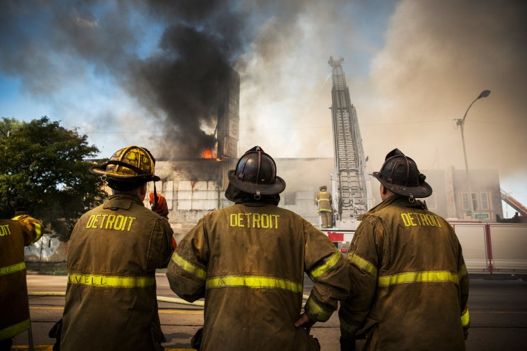 Members of the Detroit Fire Department fight a two-alarm fire that broke out in an abandoned building on September 4, 2013.