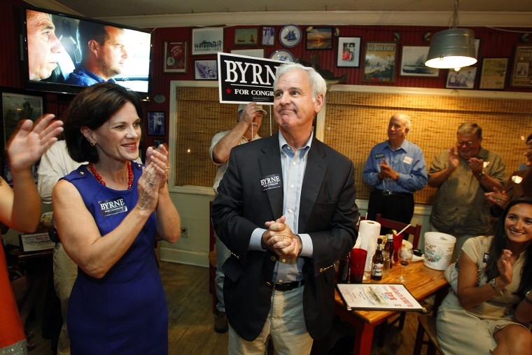 Alabama's First District congressional seat candidate Bradley Byrne greets supporters Tuesday, Sept. 24, 2013, at Ed's Seafood Shed in Spanish Fort, Ala.